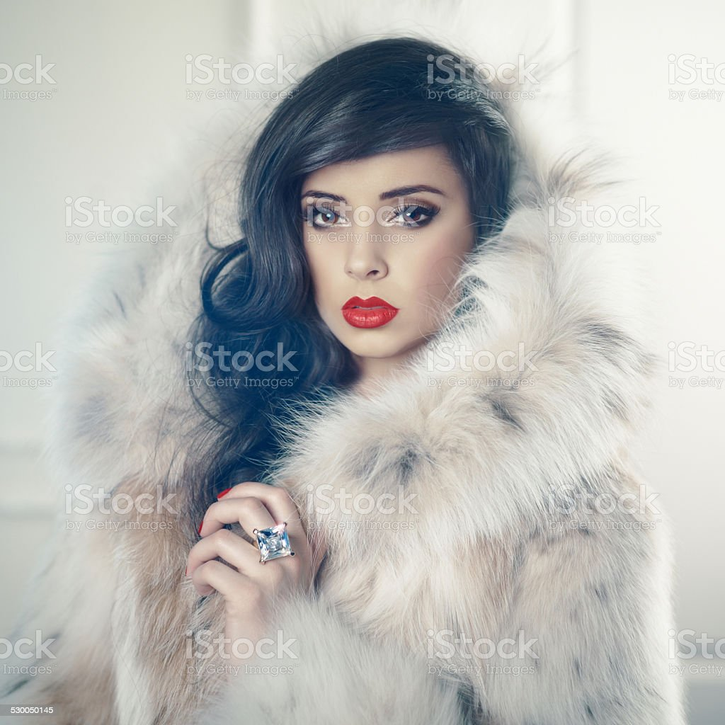 Lady in luxurious fur coat stock photo