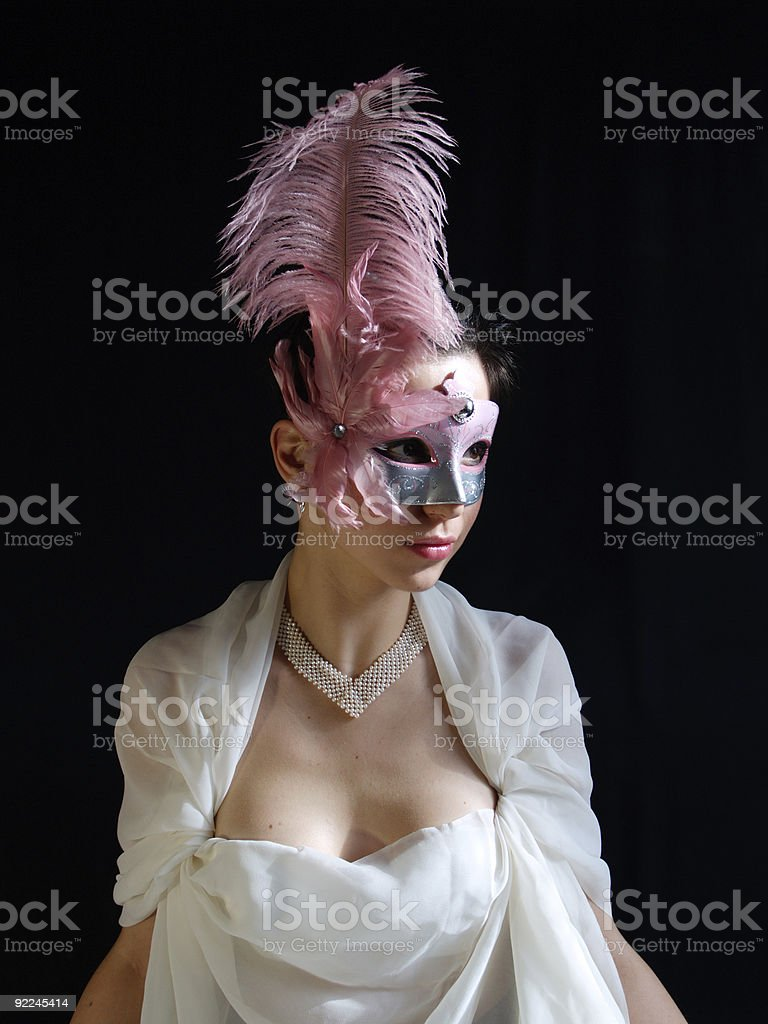 Lady in mask with feather stock photo