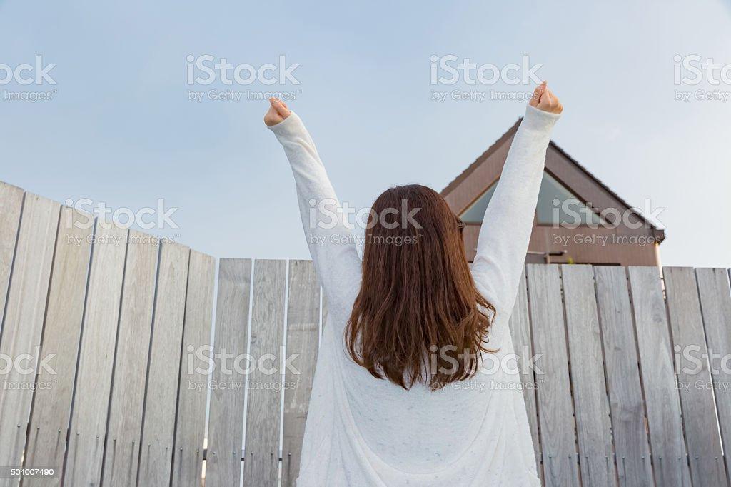 Lady in nightwear stretching stock photo