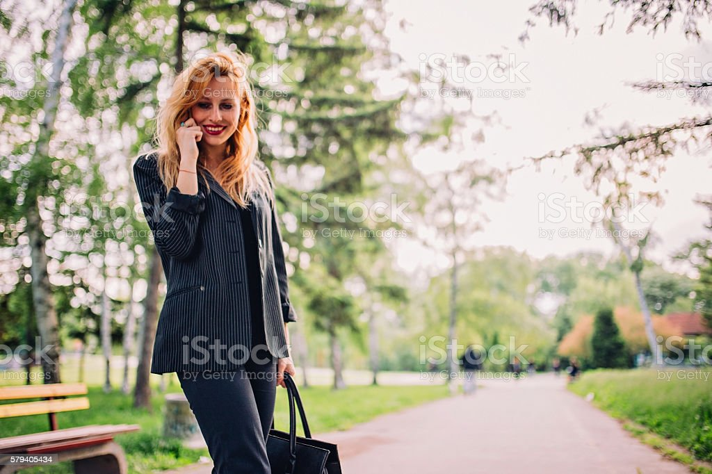 Lady in park stock photo