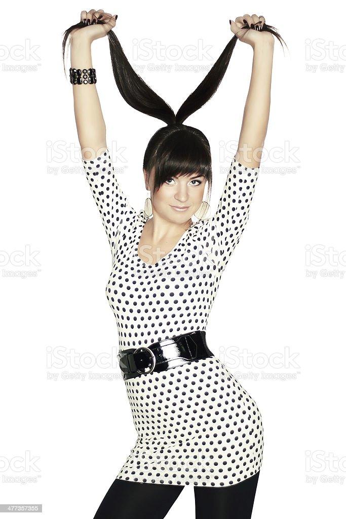 Lady in polka dot dress on white background stock photo