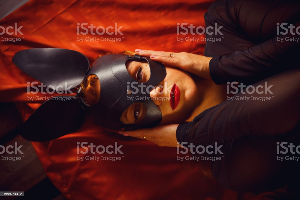 Lady in rabbit leather mask stock photo