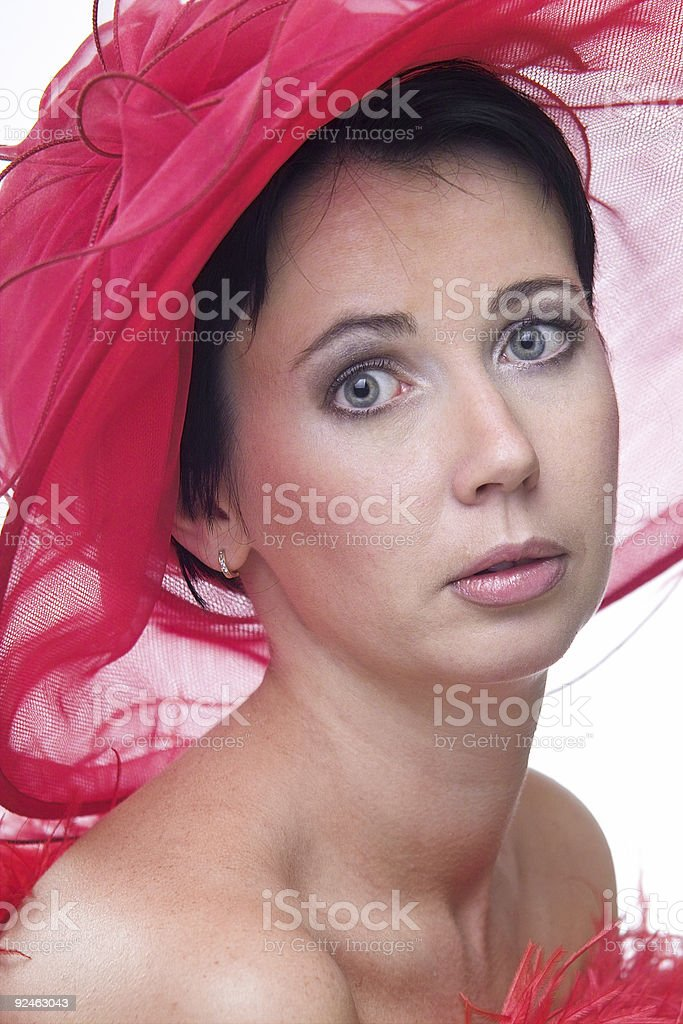 Lady in red hat stock photo