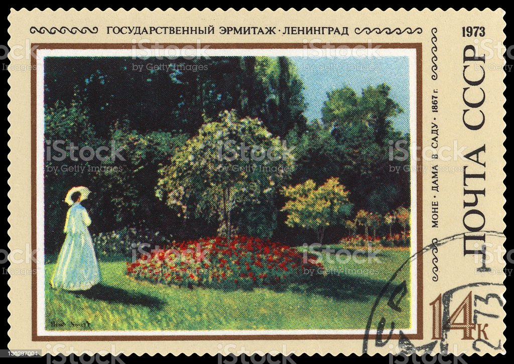 Lady in the garden by Monet postage stamp stock photo