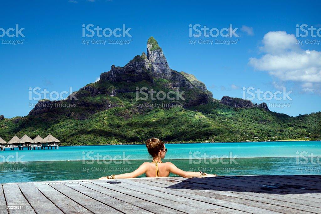 lady in the pool on Bora Bora stock photo