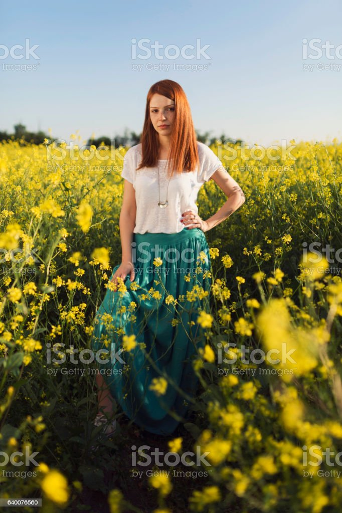 Lady in the yellow garden stock photo