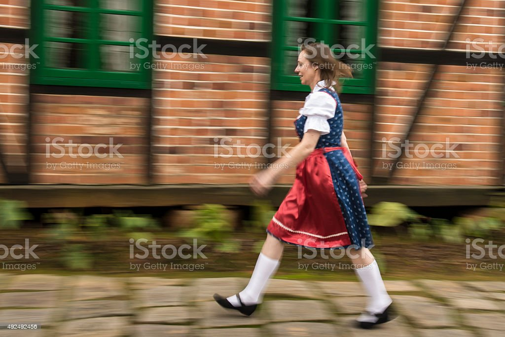 Lady in traditional dress (dirndl) stock photo