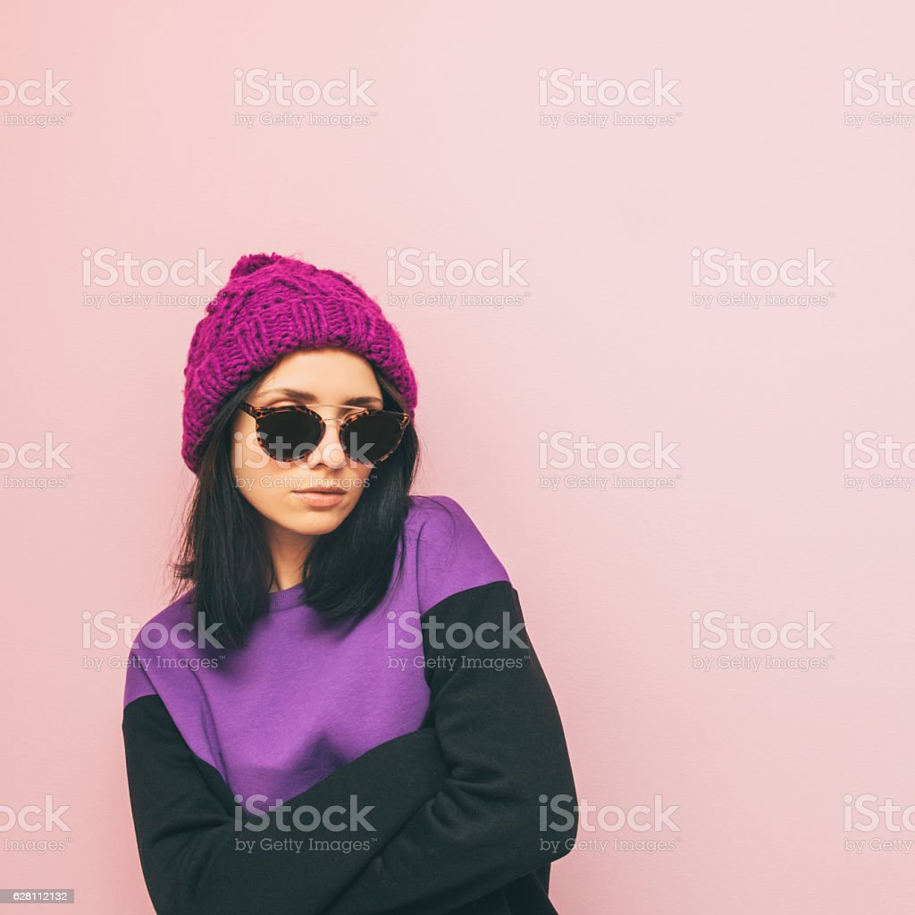 lady is standing in winter clothing stock photo