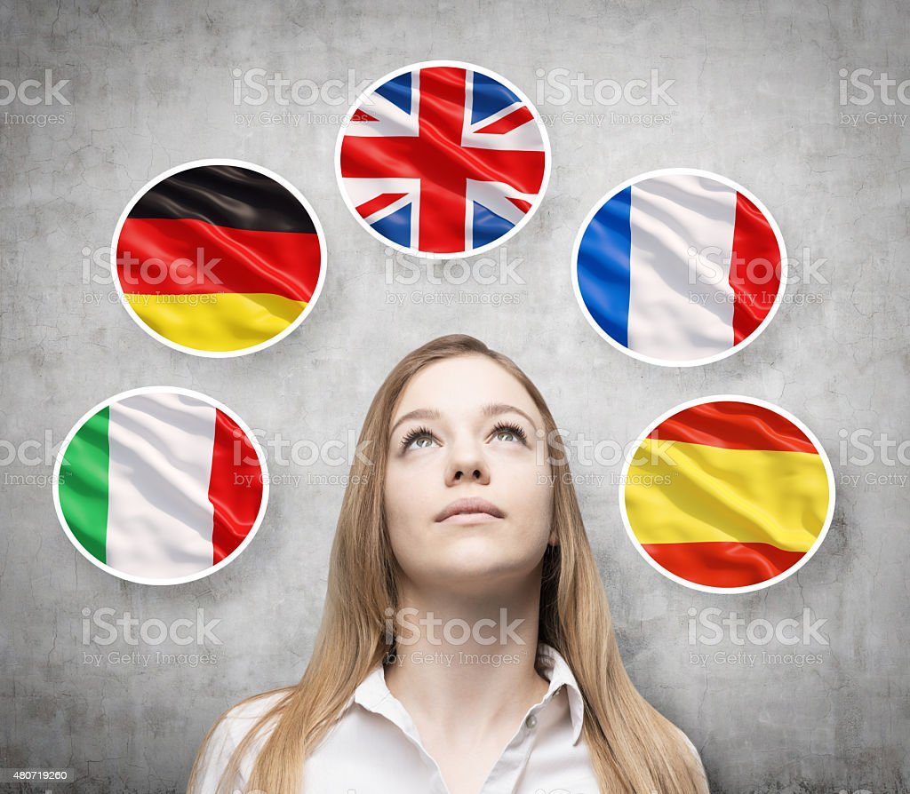 lady is surrounded by bubbles with european countries' flags stock photo