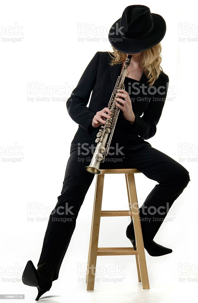 Lady Jazz musician playing the soprano saxophone royalty-free stock photo