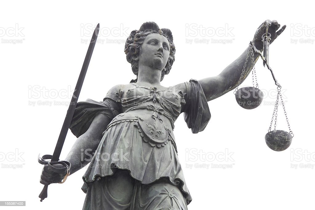 Lady Justice against white sky stock photo
