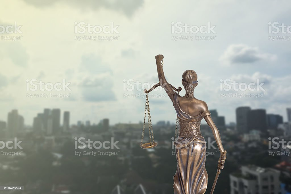 Lady Justice and city view stock photo