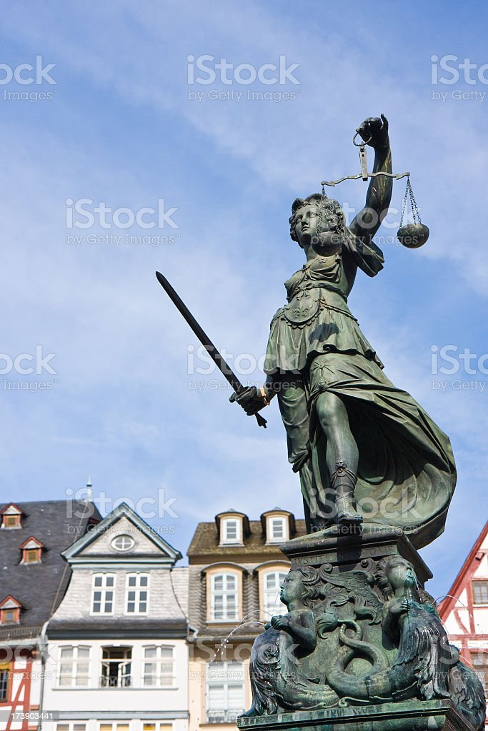 lady Justice and Frankfurt houses stock photo