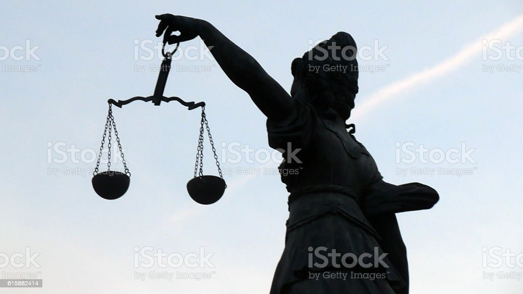 Lady Justice Holding Weight Scale By The Left Hand Side stock photo