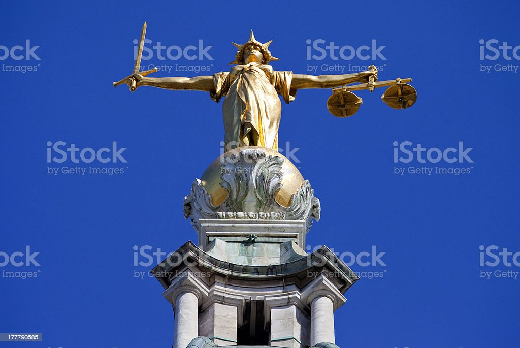 Lady Justice Statue ontop of the Old Bailey in London royalty-free stock photo