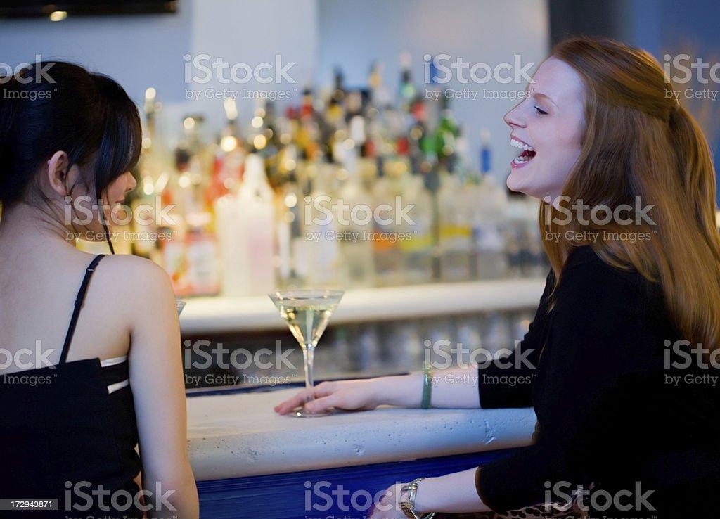 lady laughing at a bar royalty-free stock photo