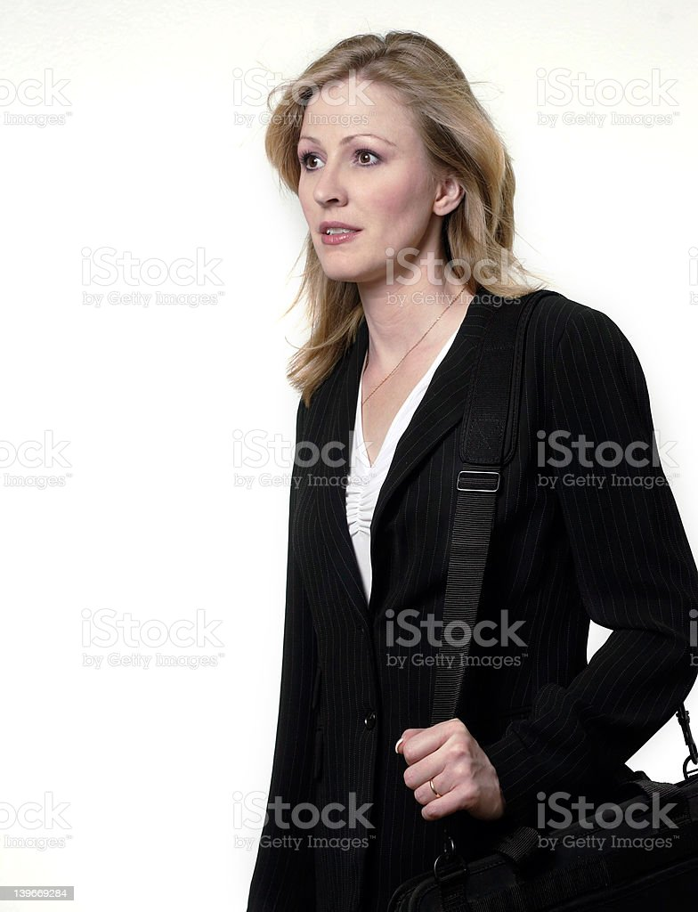 Lady lawyer walking carrying a briefcase stock photo