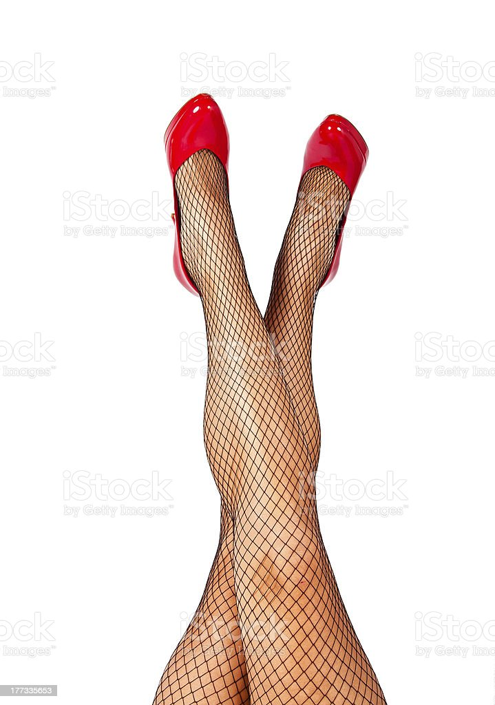 Lady legs crossed at angle stock photo