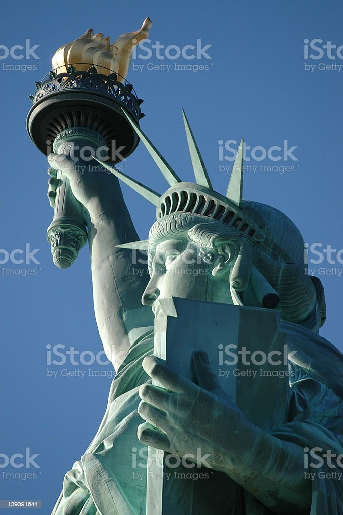 Lady Liberty-up close and personal-sunlight on fface royalty-free stock photo