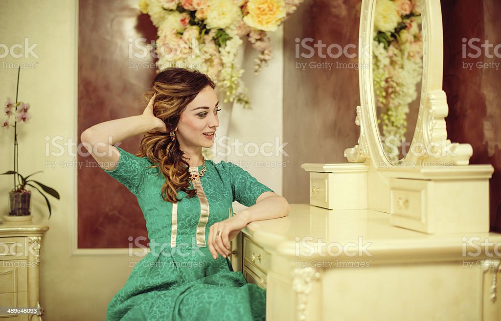 lady looking at mirror stock photo