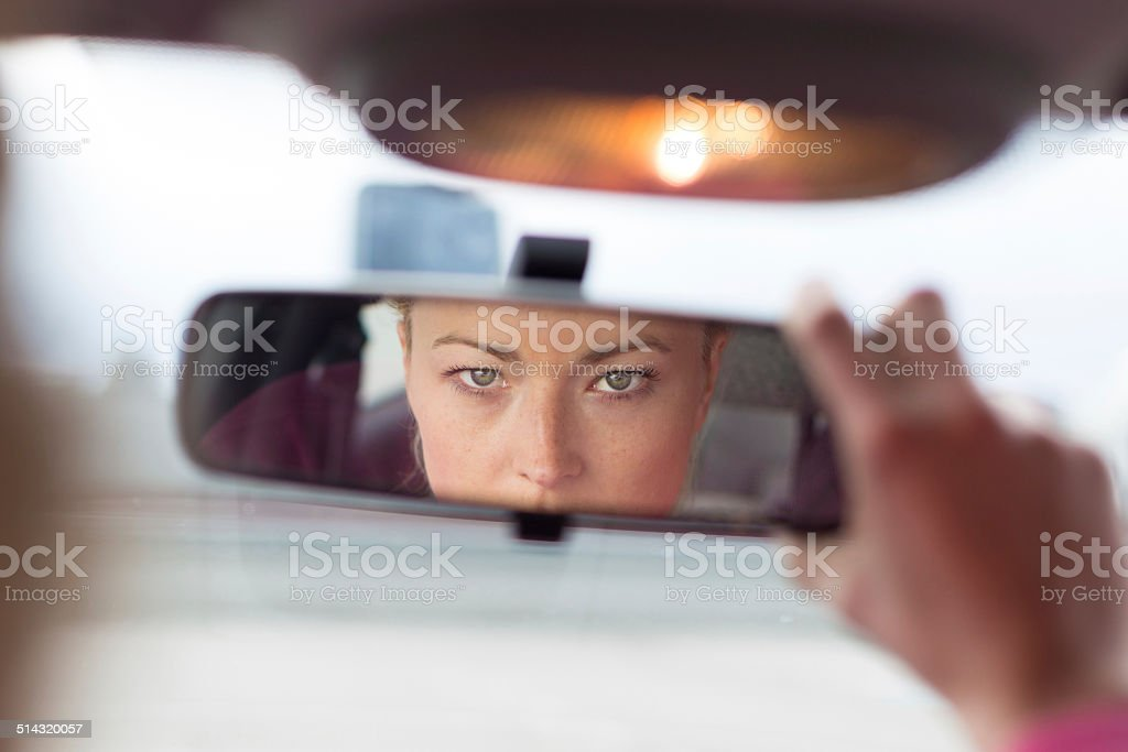 Lady looking back while reversing. stock photo