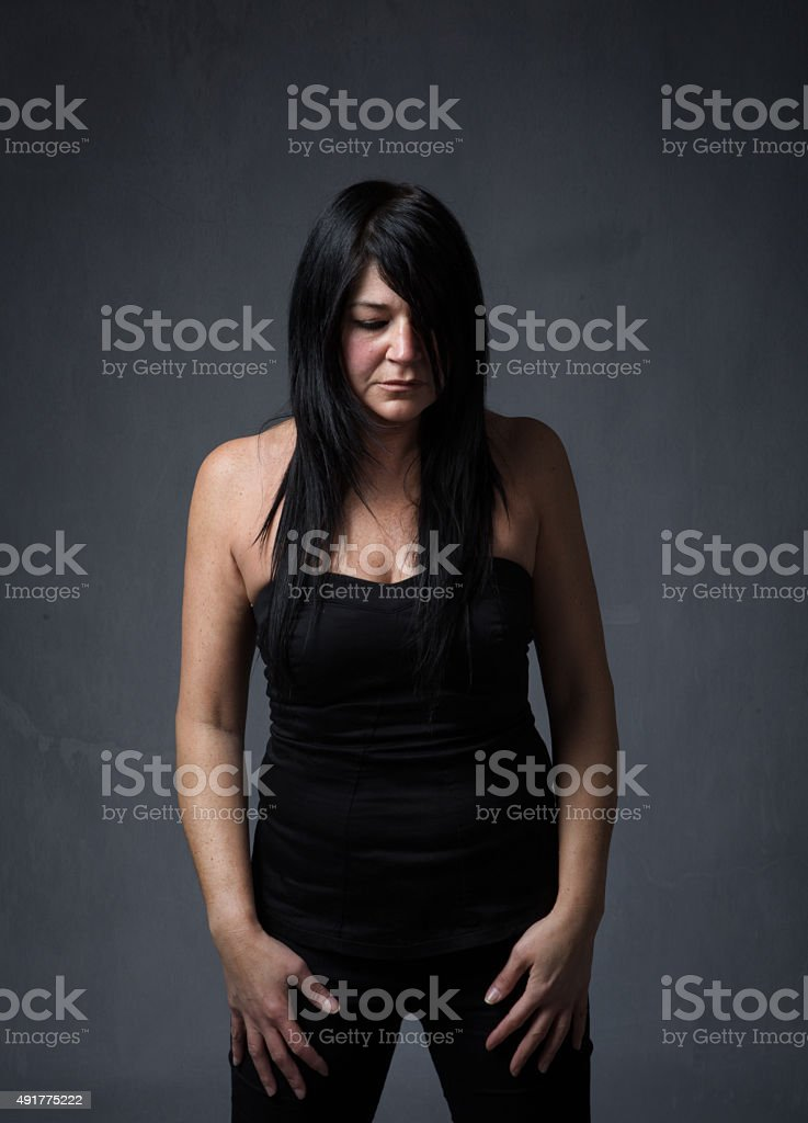 lady looking down stock photo