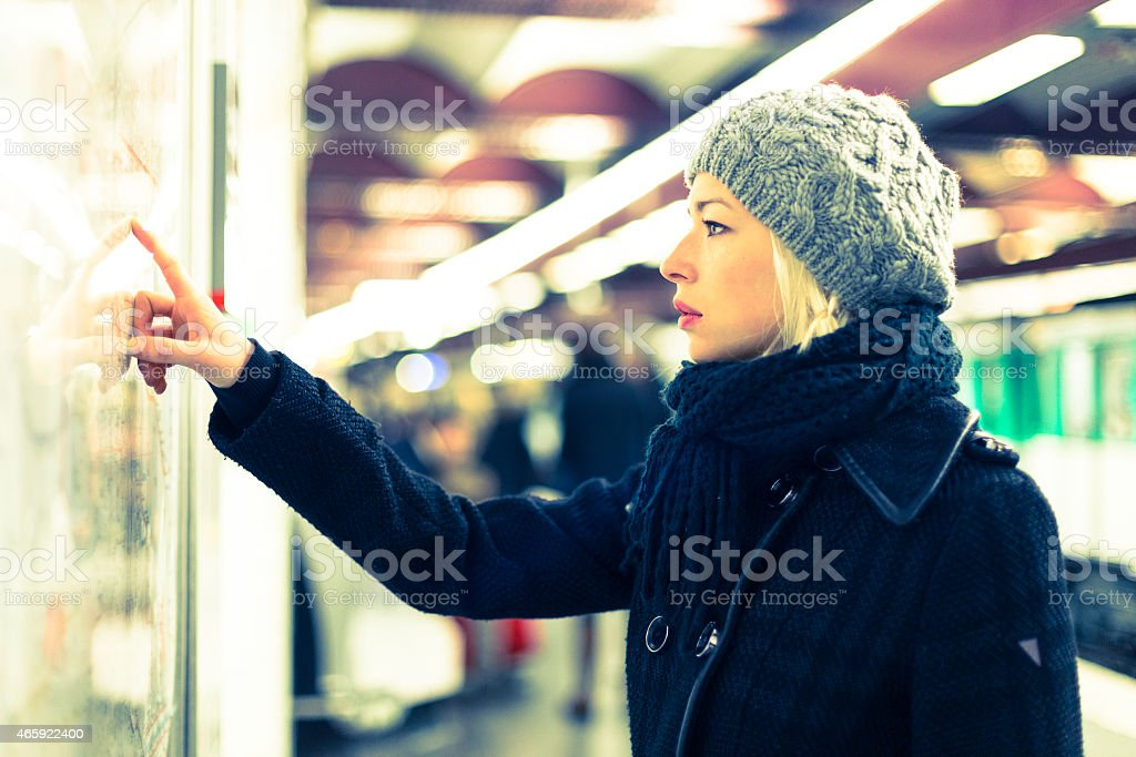 Lady looking on public transport map panel. stock photo