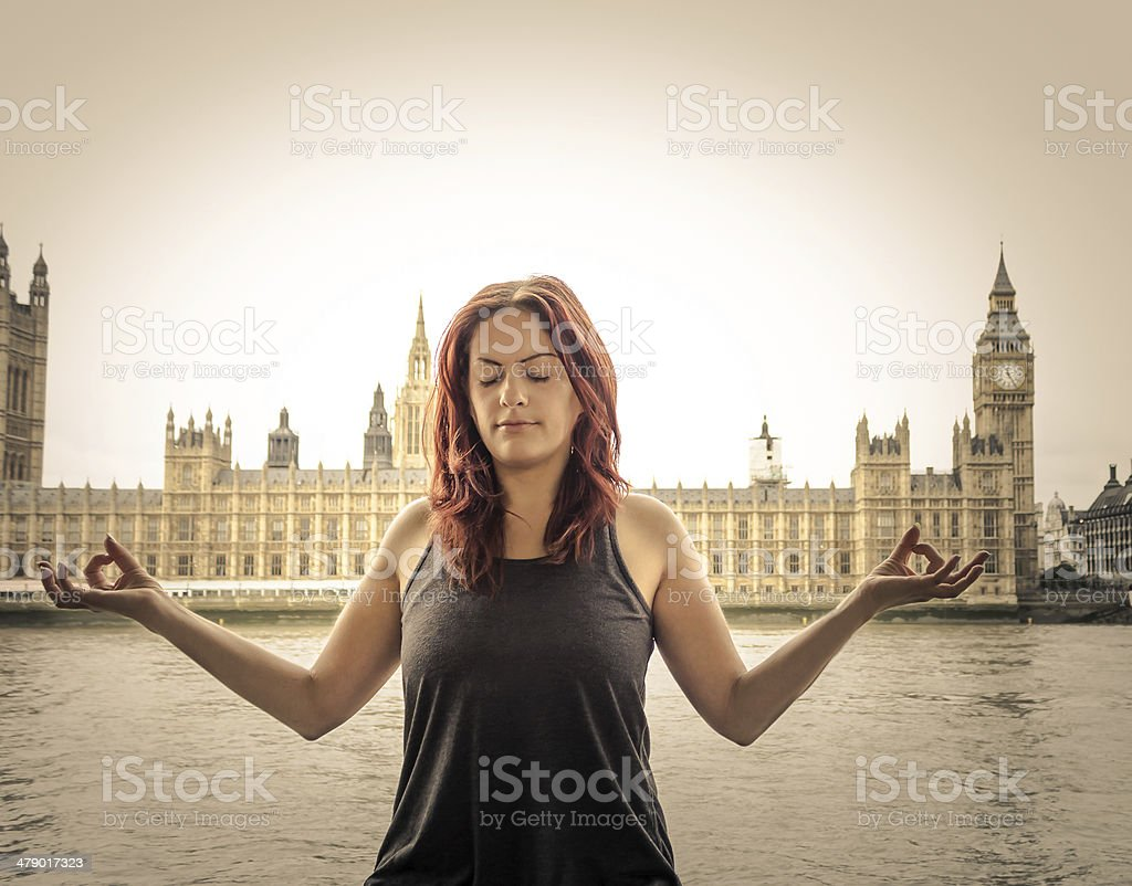 Lady Meditating in Front of Big Ben stock photo