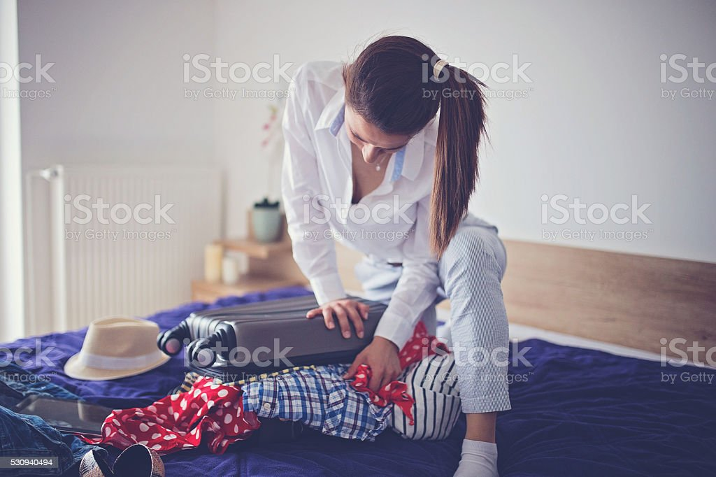 Lady needs help packing stock photo