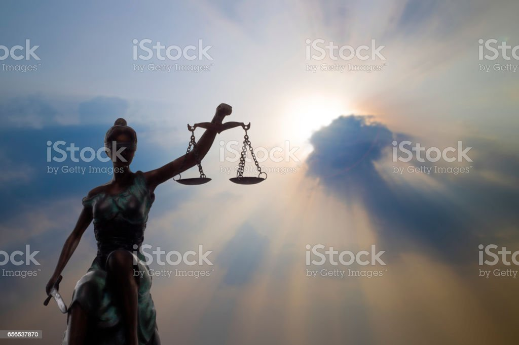 Lady of Justice and light of God stock photo