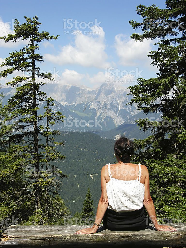 Lady on Alpine Bench royalty-free stock photo