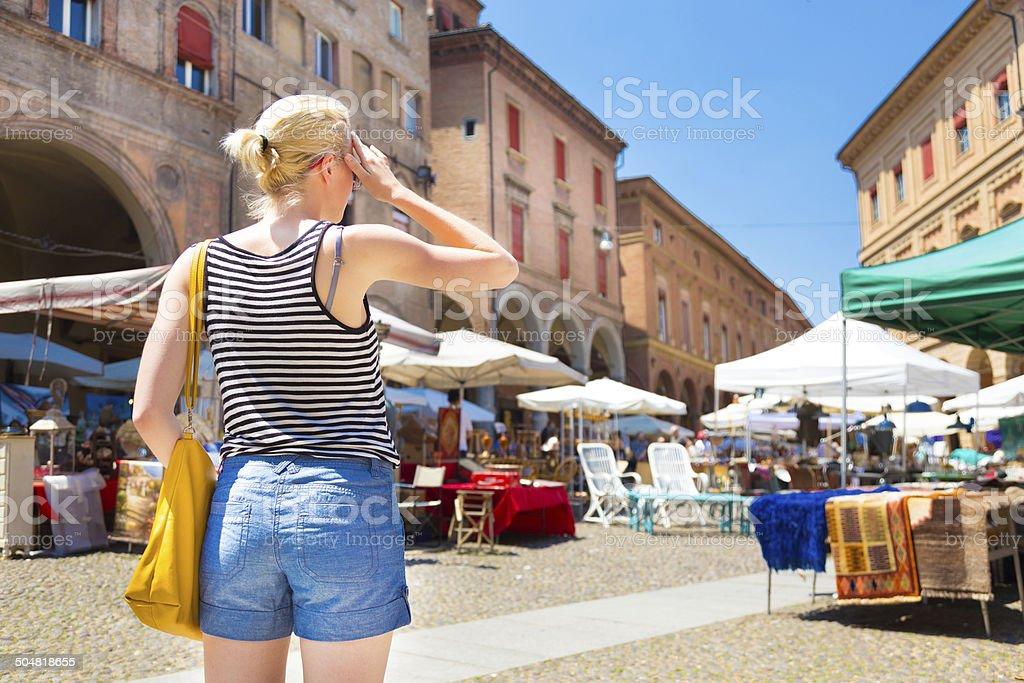 Lady on flea market in Bologna, Italy. stock photo