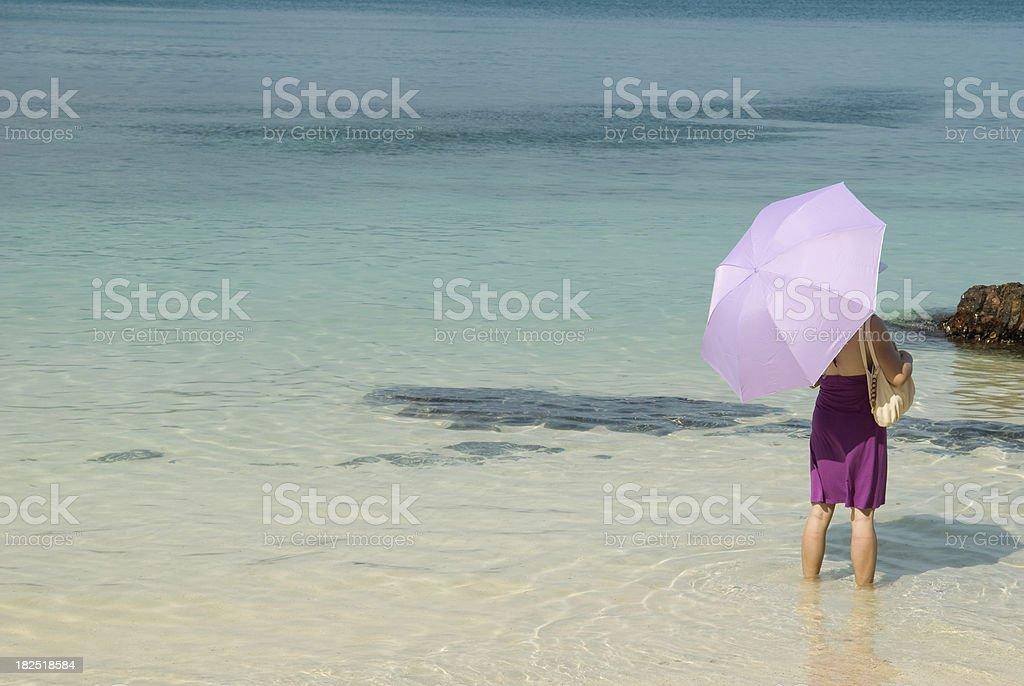 Lady on the beach stock photo