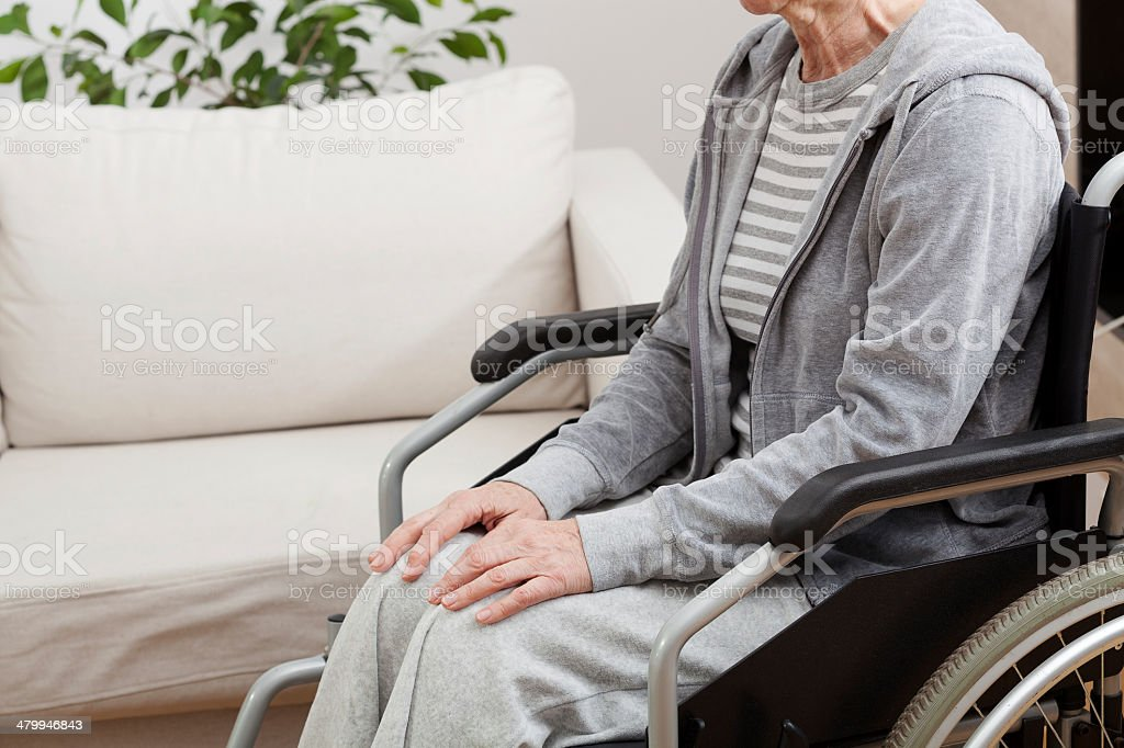 Lady on wheelchair royalty-free stock photo
