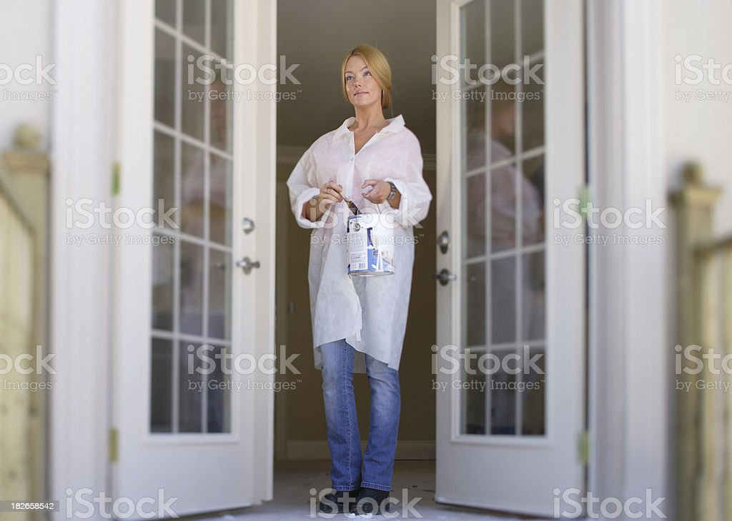 Lady painter at the door royalty-free stock photo