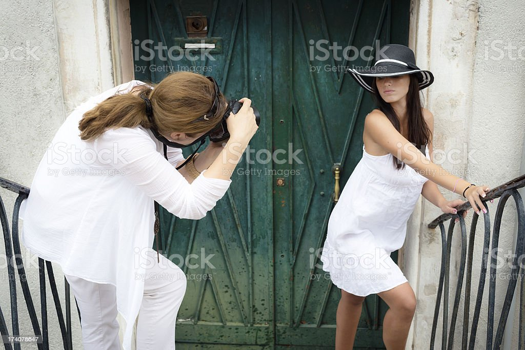 Lady Photographer and Her Model in Action Venice Italy royalty-free stock photo