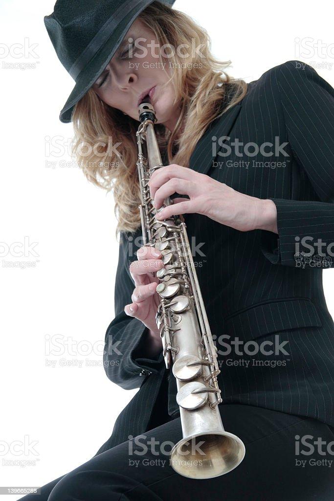 Lady playing a soprano saxophone royalty-free stock photo