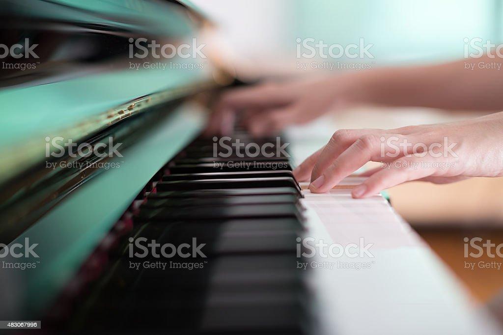 Lady playing piano stock photo