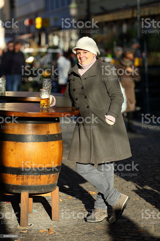 Lady Posing with Beer at Munich Beergarden in Viktualienmarkt stock photo