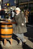 Lady Posing with Beer at Munich Beergarden in Viktualienmarkt