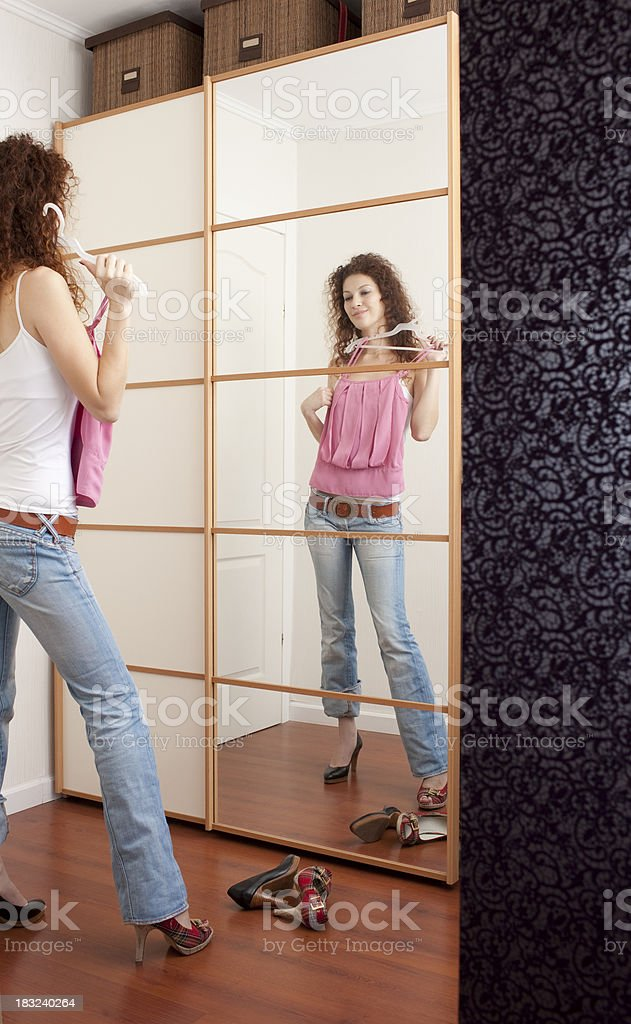 Lady preparing to go out. royalty-free stock photo