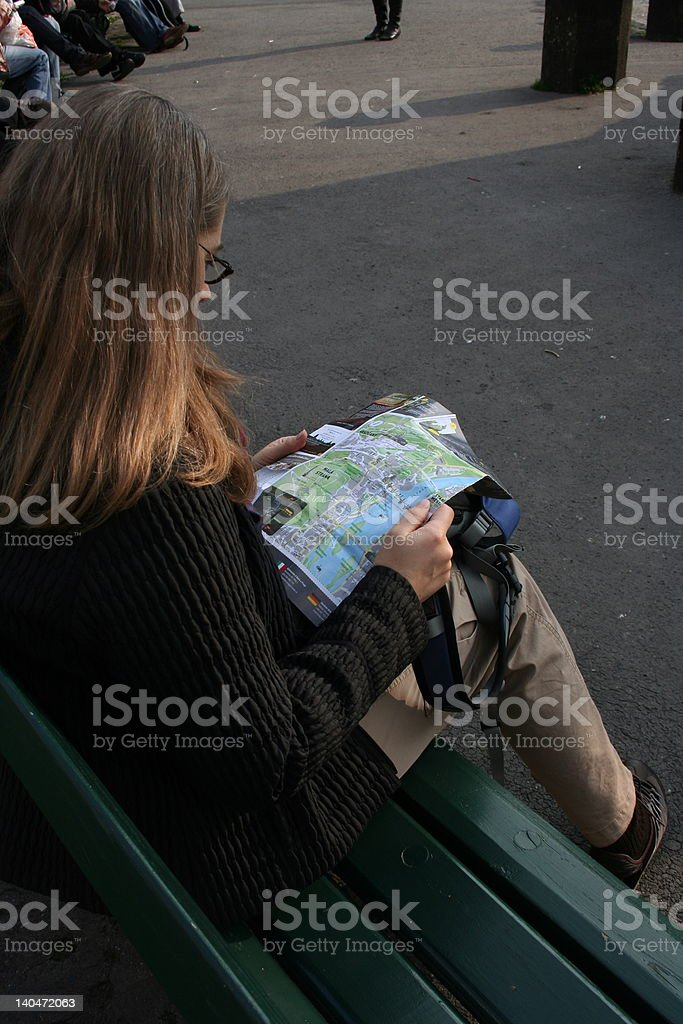 Lady reading Map on Park Bench royalty-free stock photo