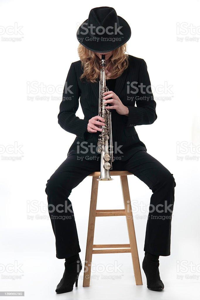 Lady saxophone player royalty-free stock photo