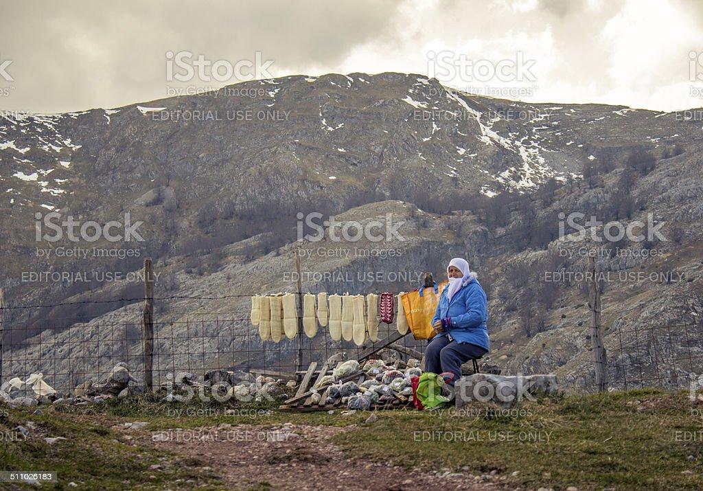 Lady selling handmade socks stock photo