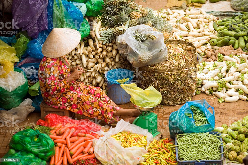 A lady selling various vegetables in Ho Chi Minh, Vietnam stock photo