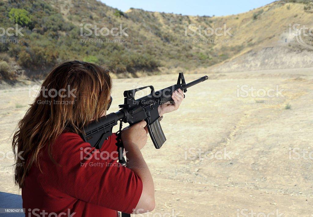 lady shooter stock photo