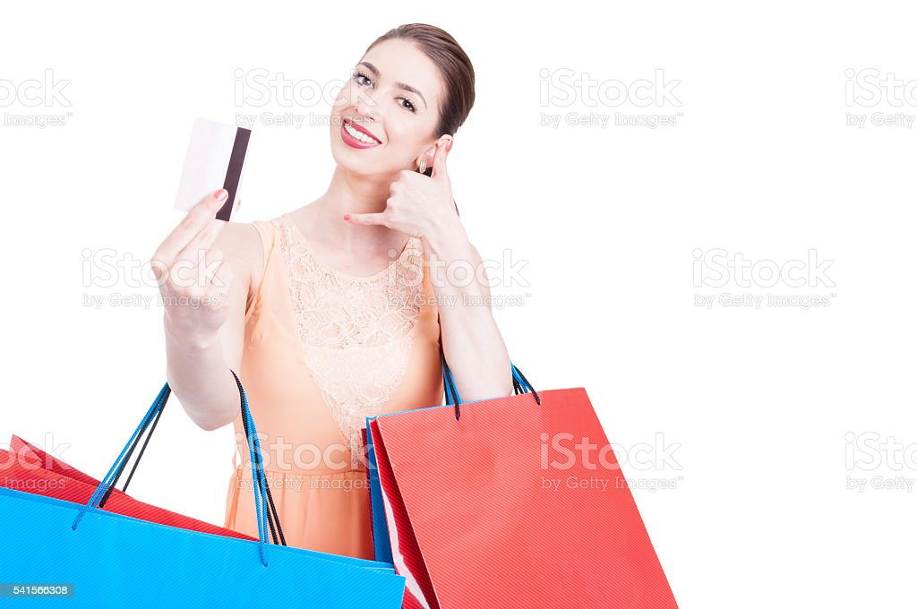 Lady shopper showing credit card and making call me gesture stock photo