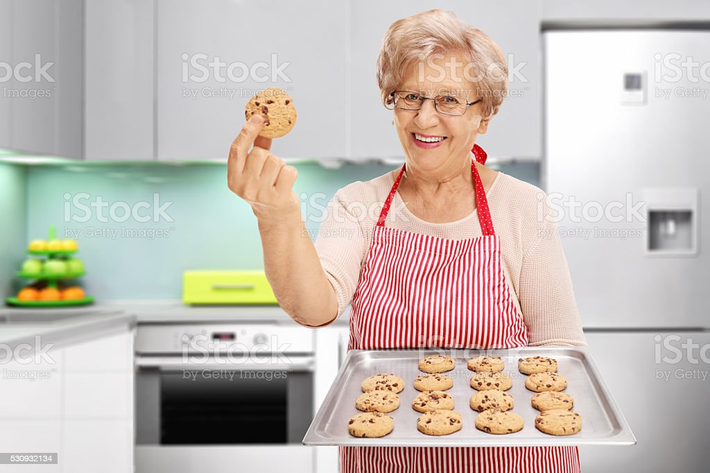Lady showing her chocolate chip cookies stock photo