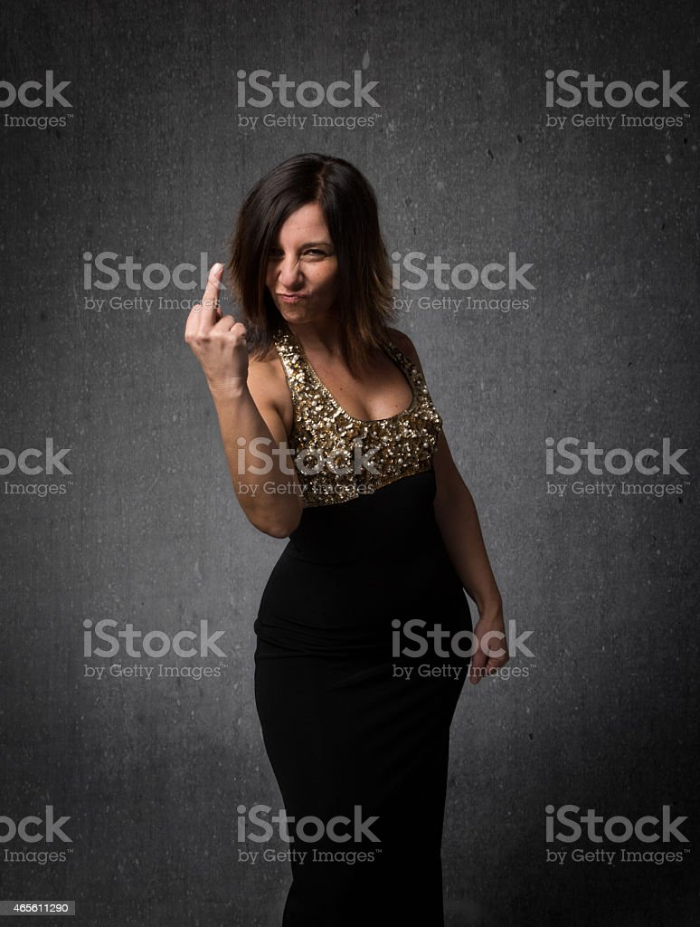 lady showing rude middle finger stock photo