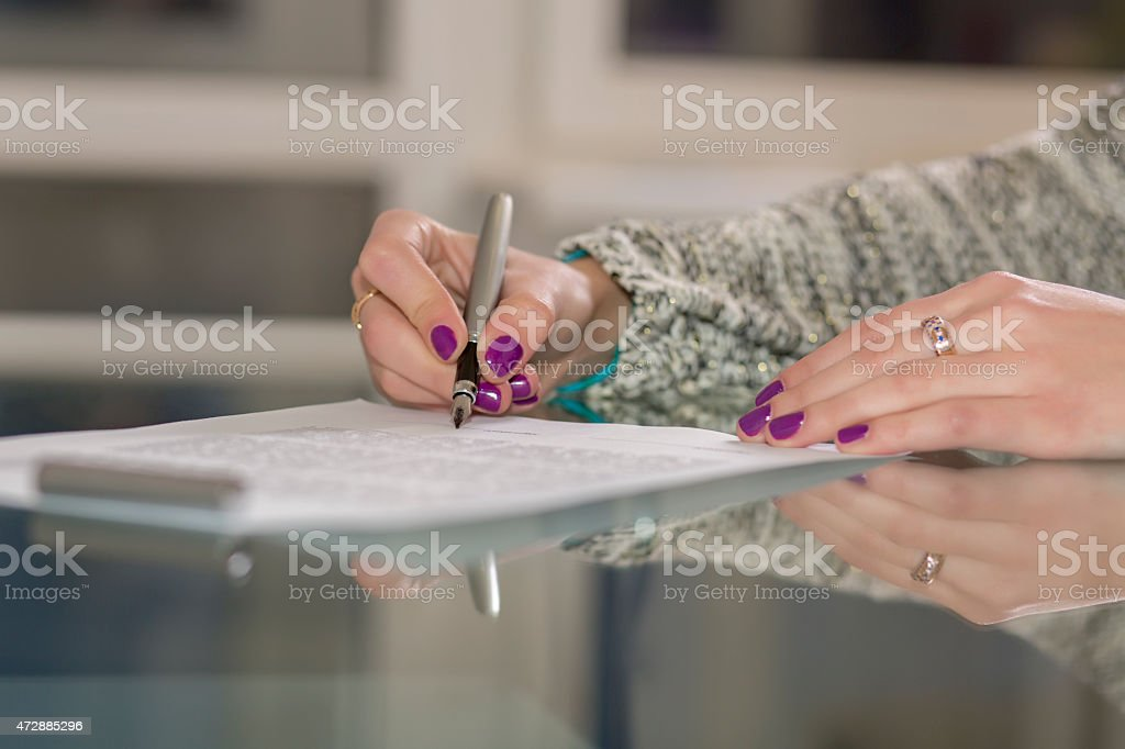Lady signs contract stock photo